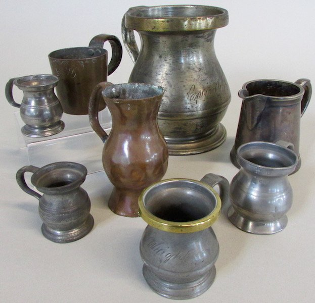 Group of Measures and Cups