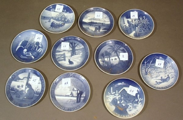 25: Ten blue Copenhagen Christmas plates.