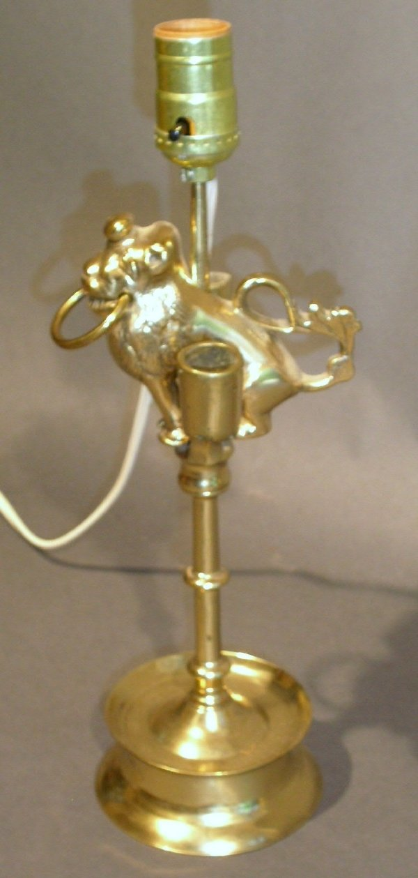 """115: Brass table lamp with lion figure. 19.5""""h."""