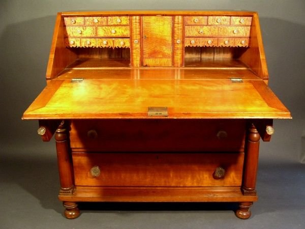 217: Empire cherry slant-lid desk with bird's-eye maple