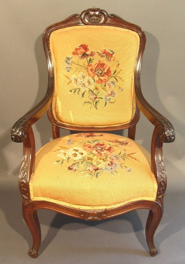 253: Carved mahogany open armchair with needlepoint uph