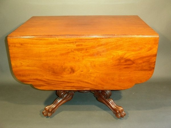 261: Mahogany breakfast table with acanthus carved pede
