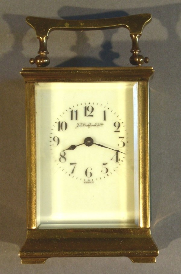 272: J.E. Caldwell carriage clock, brass and glass. Chi
