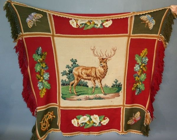 18: Victorian crocheted coverlet with stag motif. Some