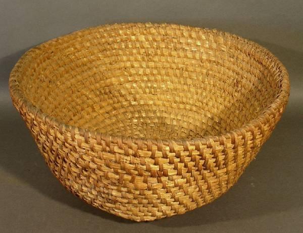 """24: Rye straw basket with a cross base, 10""""hx20.5"""" diam"""