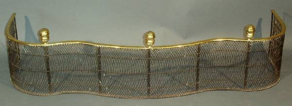 29: Fire fender, brass and wire with serpentine front.