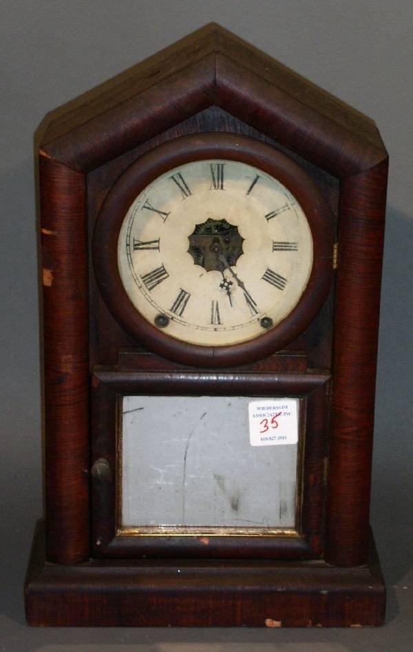 35: Rosewood veneered mantel clock. Veneer losses, dama