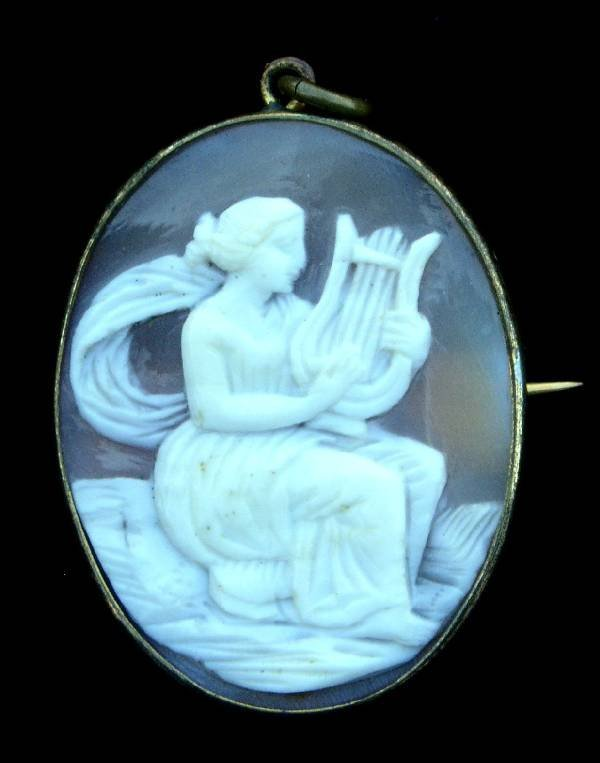 """40: Oval cameo brooch with lyre player, 19th c. 1.5""""x1"""