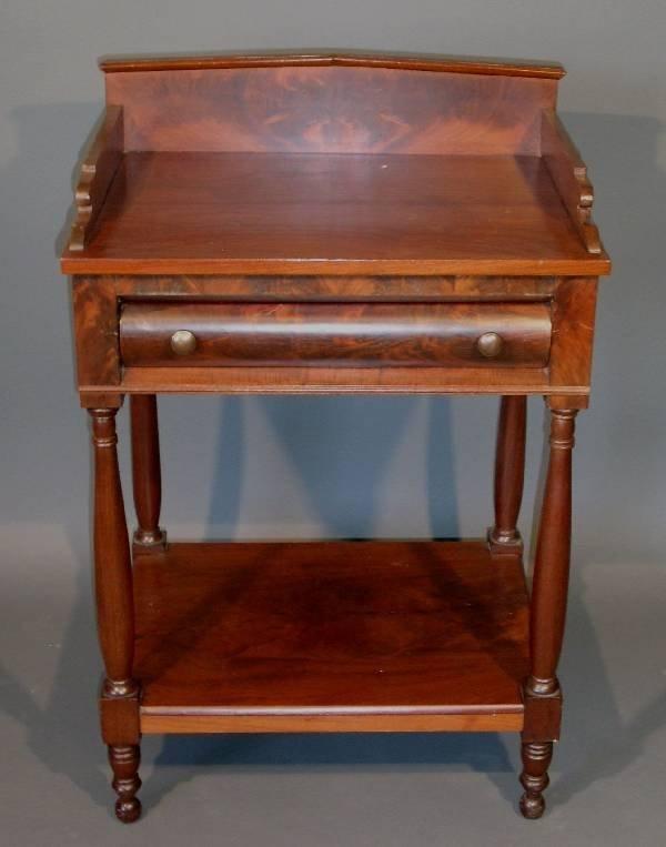 257: Sheraton mahogany and walnut stand, single drawer,