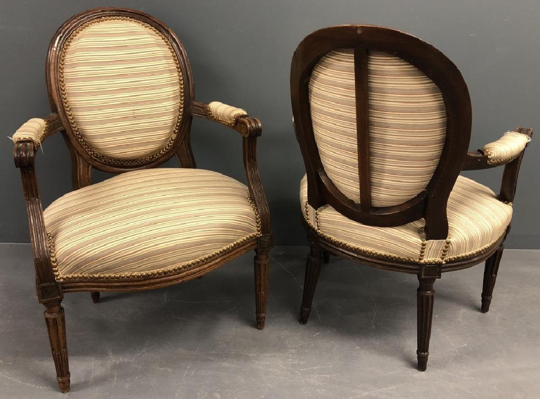 Pair of French Louis XVI Walnut Open Armchairs