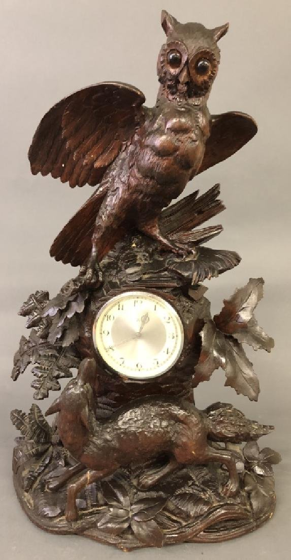 Black Forest Clock with Carved Owl and Wolf