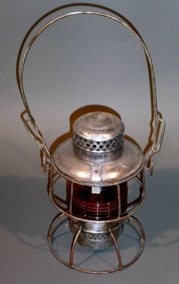 "12: Railroad lantern, Adlake, PRR on frame. 9.5""/16.5""h"