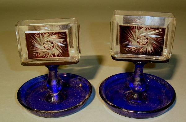 """322: Pair of cut glass cigarette holders. 4.5""""h.x 5""""H"""