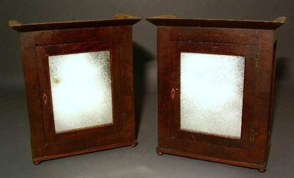 323: Pair of mirrored mahogany veneered storage boxes
