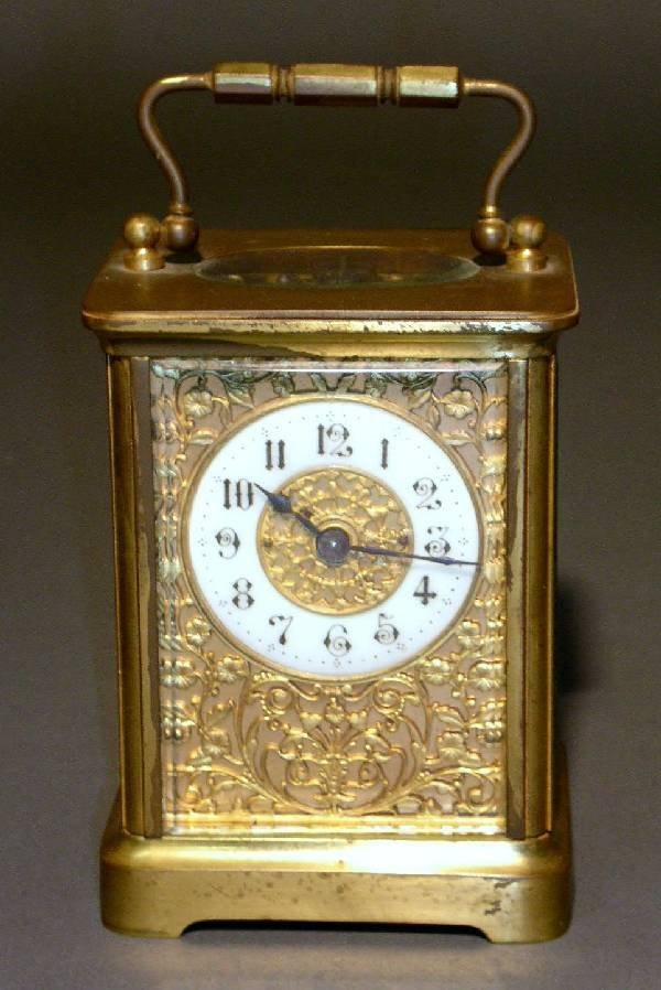 329: French carriage clock, brass with beveled glass.