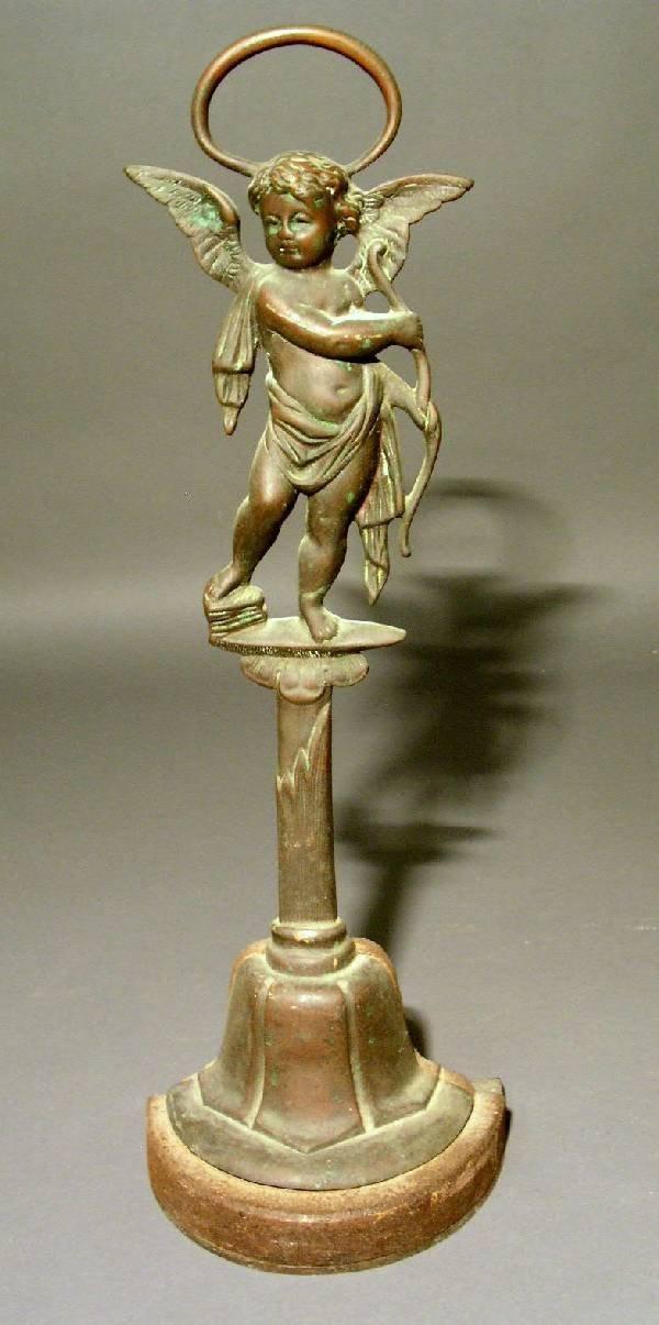 """343: Victorian brass cherub doorstop. 17.5""""h.x6""""w.x4"""""""