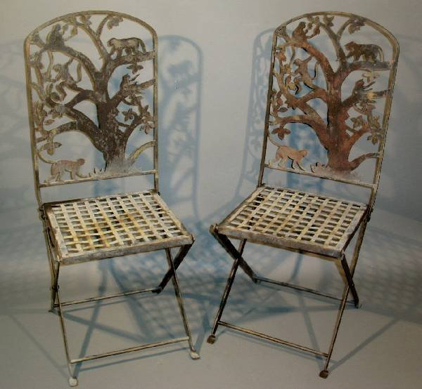 505: Pair of wrought iron folding garden chairs with