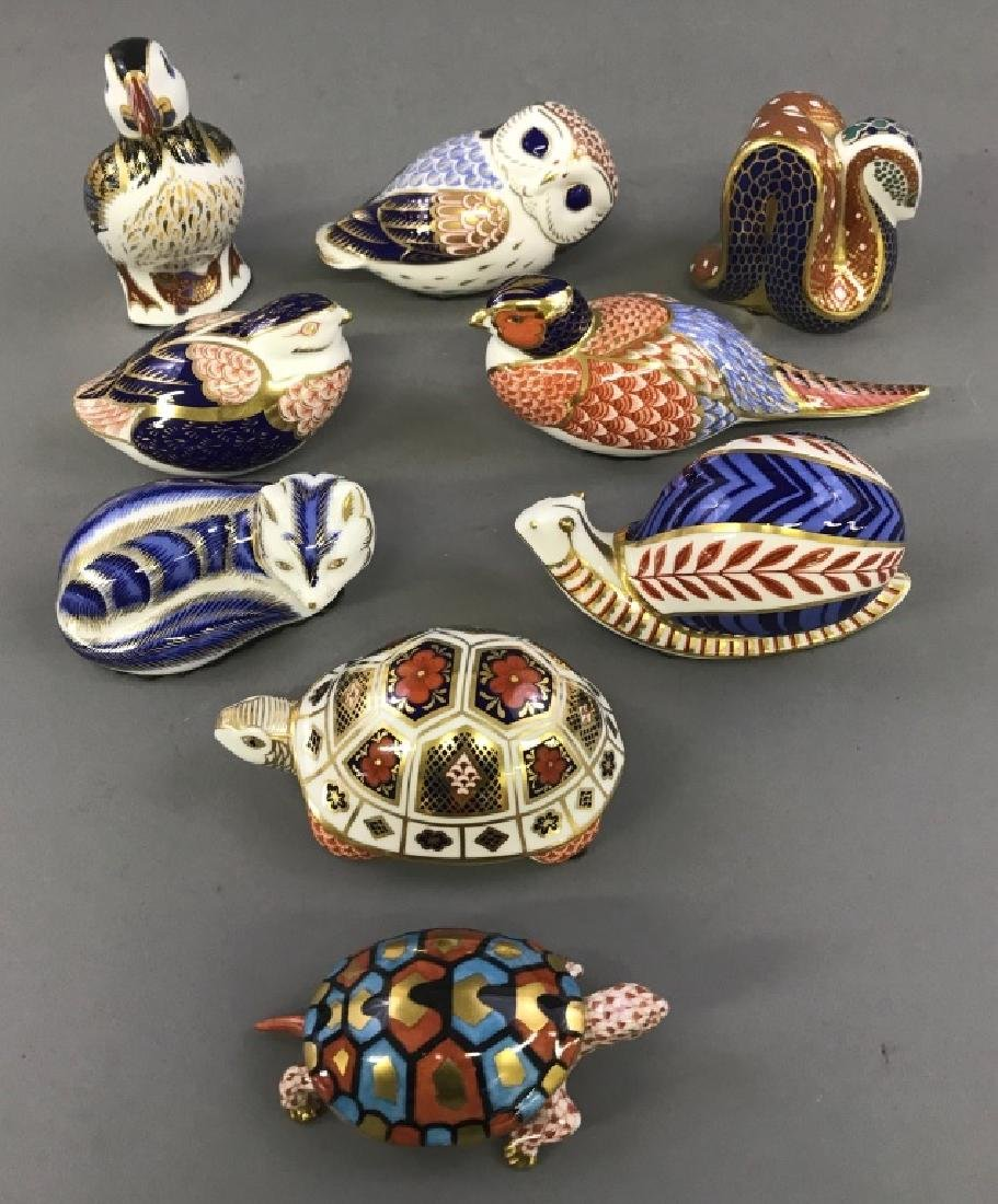 Eight Royal Crown Derby Porcelain Figures