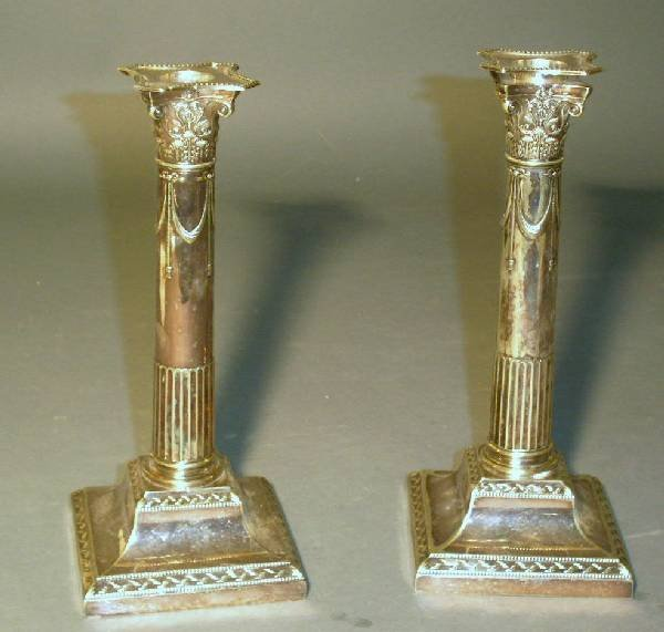 15: Pair of weighted silver Corinthian candlesticks. 9.