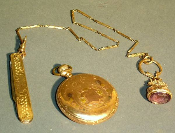 24: Elgin 14k gold pocket watch, watch chain with penk