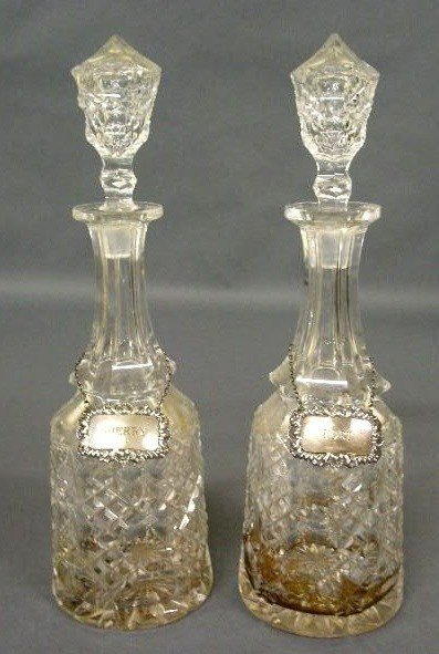 373:   Pair of crystal decanters with silver wine label