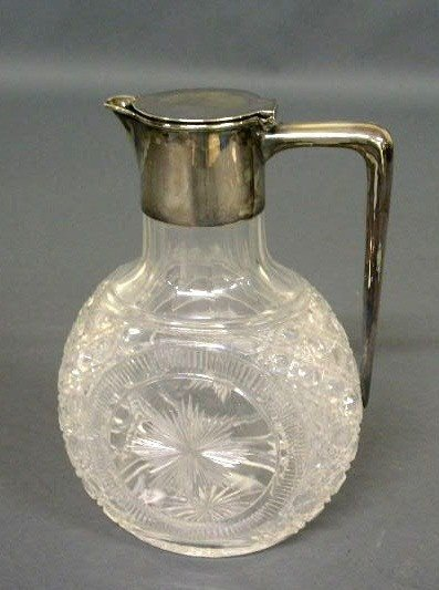 "375:   Cut glass pitcher with silver lid & handle. 8""h."