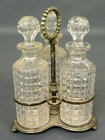 377:   Three-piece decanter set with silverplate stand.
