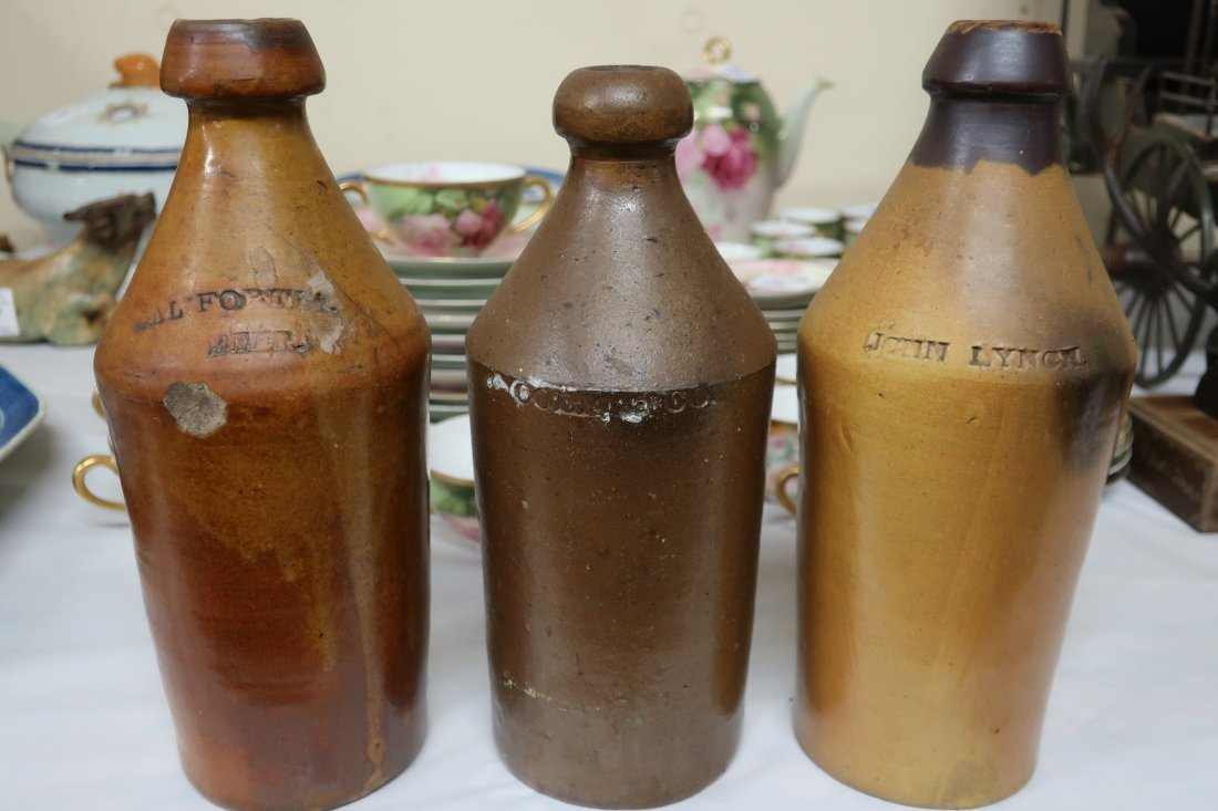 Eleven Stoneware and Redware Jugs and Bottles - 4