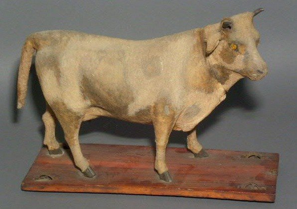 13: German milking cow pull toy, late 19th c., with hid