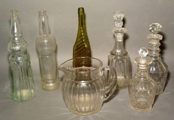 25: Three glass bottles incl. one brown, three cut crys