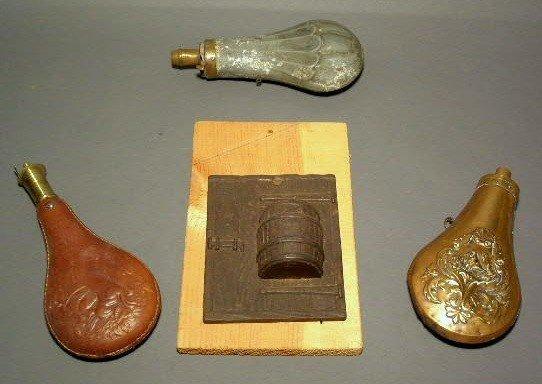 254:  Three powder flasks and hanging match holder.
