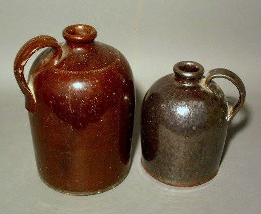 """273:  Two redware jugs one w/iron glaze 9""""h. and one w"""