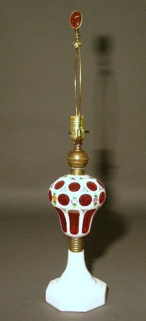 """17: Cranberry glass oil lamp, electrified. 27.5""""h."""