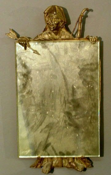 19: Cast metal mirror, c.1920, with pictorial of a Moor