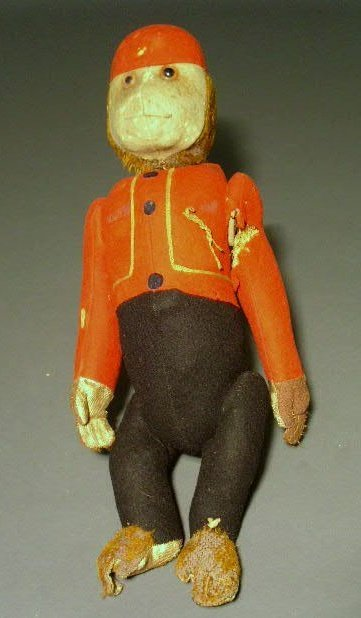 20: Organ grinder monkey with wool clothing and rotatin