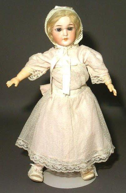 """21: Schoenau & Hoffmeister bisque head doll. 23""""h."""