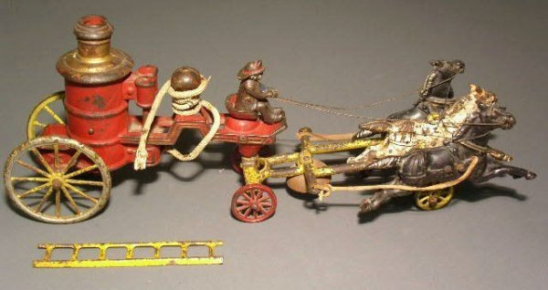 22: Cast iron toy fire pumper with driver and three hor