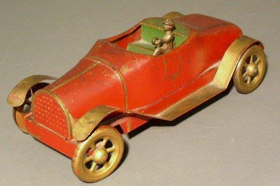 24: Metal toy convertible car, c.1920, with original pa