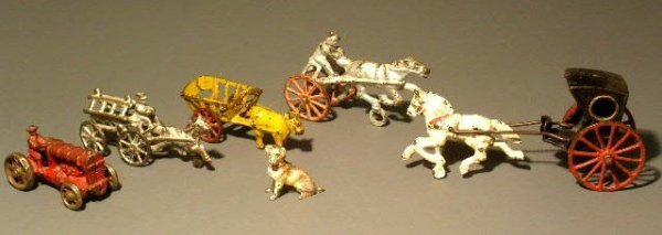 25: Five metal toys and a cold painted dog. largest is