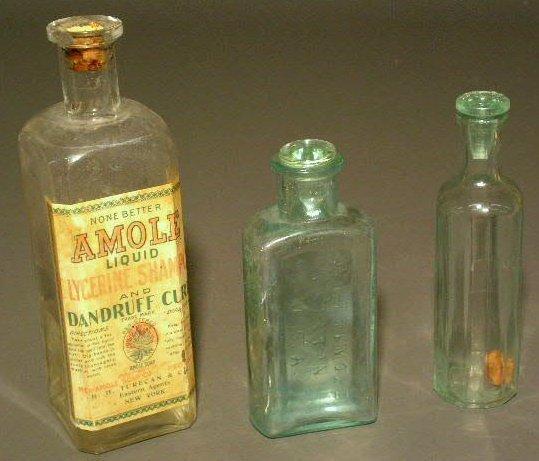 """29: Three bottles- Dandruff Cure 8.5""""h., Whit Trevor- B"""