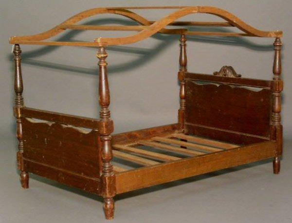 "30: Mahogany canopy doll bed, c.1940. 20.25""h.x26.25""l."