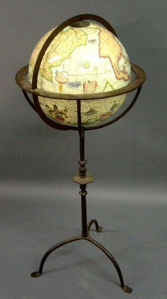 "21: World globe on a wrought iron stand. 42""h.x16""diam."