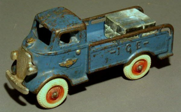 24: Cast iron toy ice truck by Arcade, blue paint decor