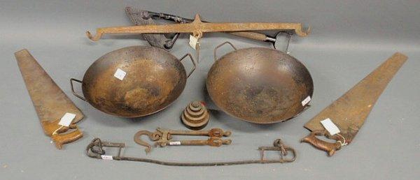 24: Eight metalware items- two woks, cutting tool, two