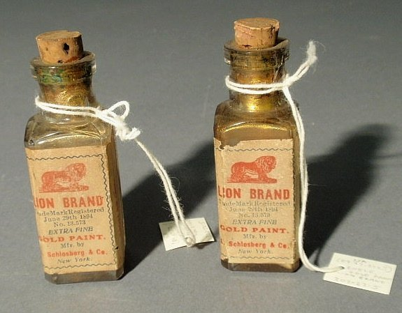"""25: Two bottles """"Lion Brand Extra Fine Gold Paint June"""