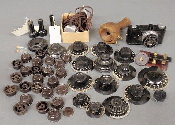 32: Box lot of radio dials, camera, etc.