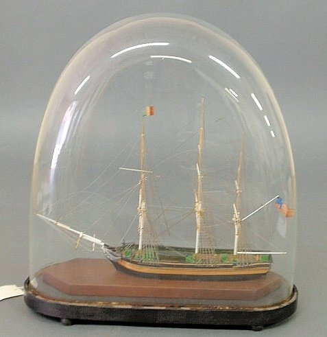 """43: Wooden ship model in a dome glass case. Overall 17"""""""