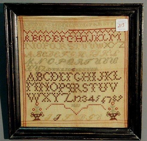 "213: Sampler dated 1857, silk on linen. 15""x14"