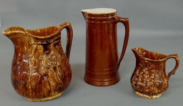 """5: Two Bennington type pitchers 10"""" & 7""""h. and a gla"""