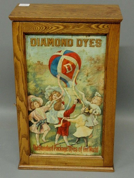 "24: Oak trade cabinet with painted tin door ""Diamond"